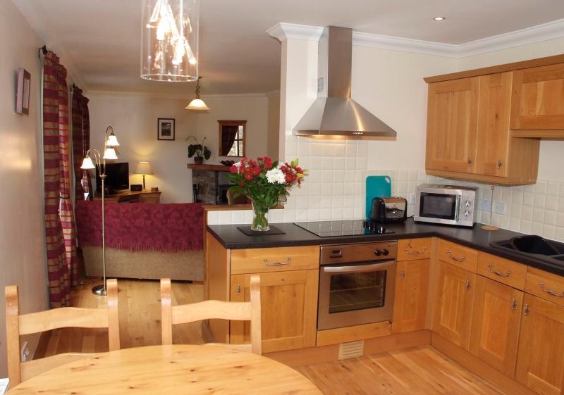 Modern kitchen/diner, through to the lounge
