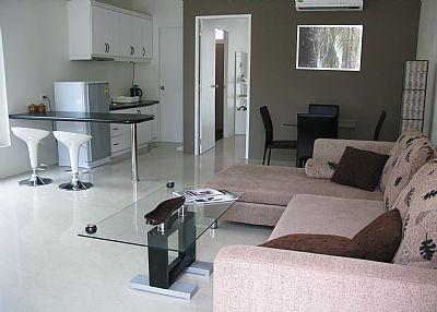 Air conditioned living room with open plan kitchen