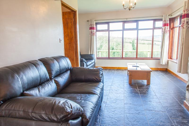 Lounge with stunning views over the ponds and countryside