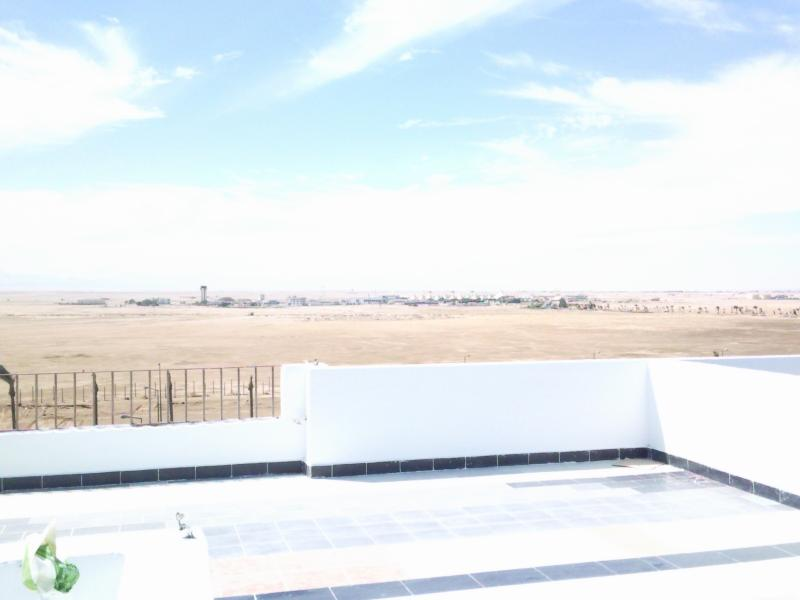 view of desert from roof