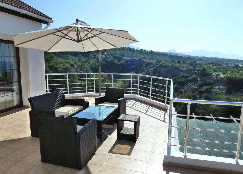 Sit in comfort on the upstairs terrace suite with magnificent sea and mountain views