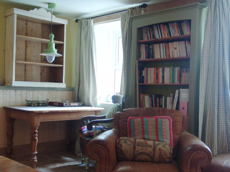 A desk and shelving by the window for artists and writers. Fully stocked bookcase for rainy days and