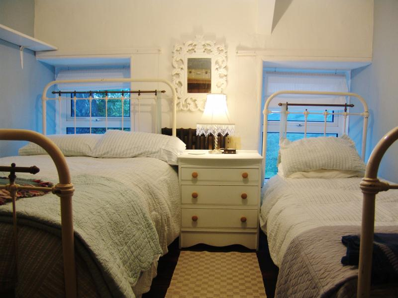 Guest bedroom; comfortable new mattresses on vintage double and single beds
