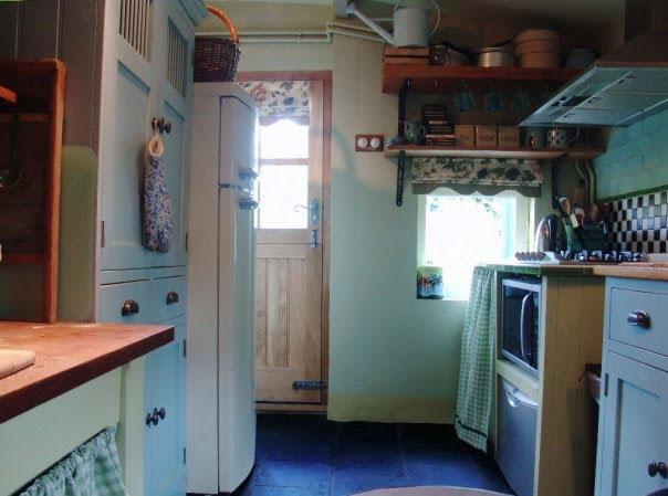 Kitchen facing back (stable) door; dishwasher, microwave and very well-equipped for cooking