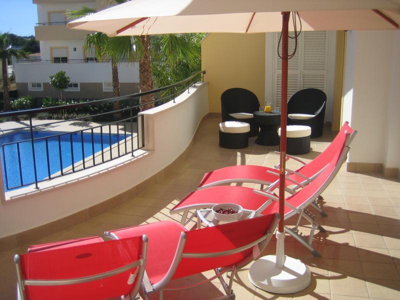 Expansive sun balcony overlooking pool