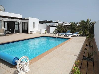 Large terrace with covered pergola,garden and pool area.