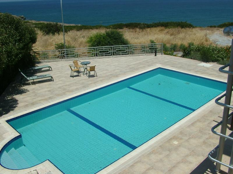 Pool and patio with seaview