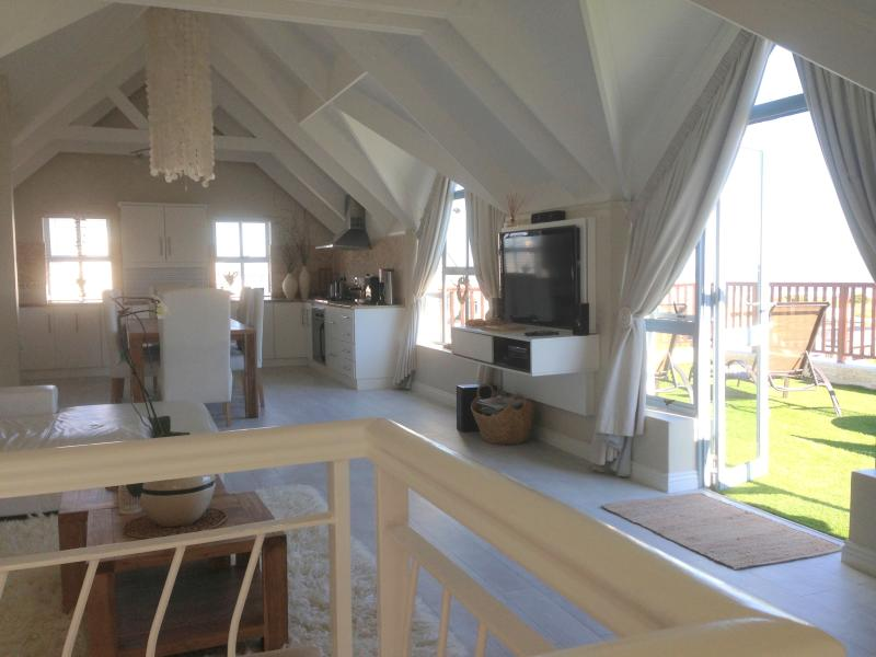 View from the staircase to the Living / Dining Area and the door opening to the terrace