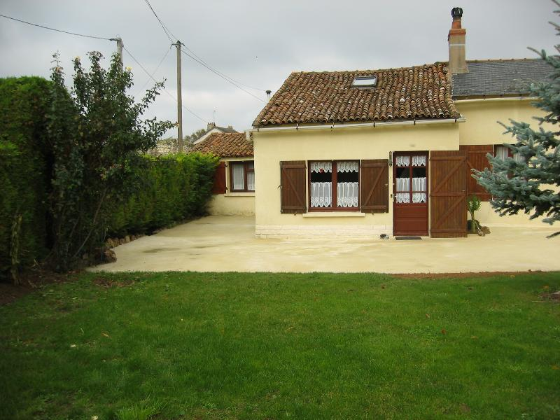 Cottage front.Grassed area between kitchen and BBQ.All rooms with original beams & 3 pin sockets