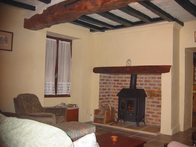 Lounge with wood burner for the central heating. Music centre, dvd & video players. CDs DVD also