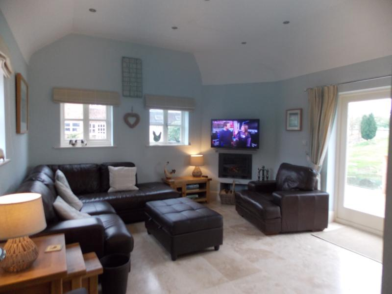 Lounge/Living area with log fire, Freeview Television & DVD player