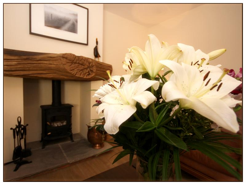 Lounge with fresh cut flowers each week, cosy log burning stove + oil fired heating