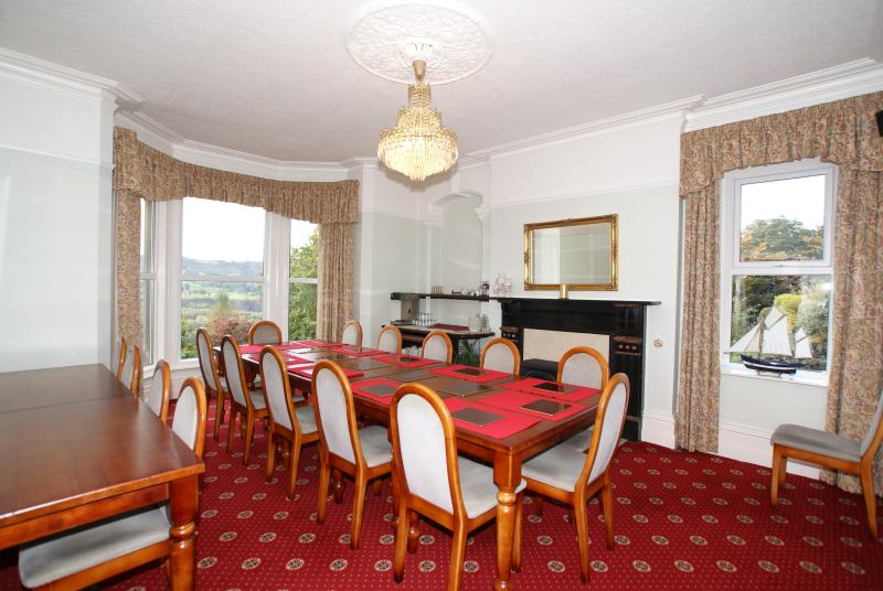 South facing Dining Room. Set here for 12 but will comfortably seat 18 Adults.