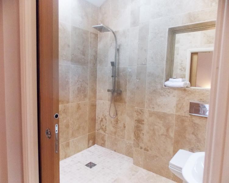 En Suite bathroom for Bedroom 2 - Easy access wet room, with sliding door.