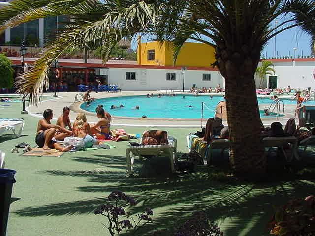 Pool area with plenty of sun beds.