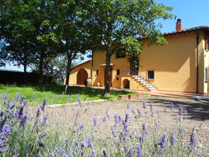 The Villa from the front with its beautiful garden full of aromatic herbs and trees.