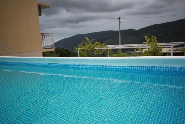 The Pool with Sea View over the Vine Terrace