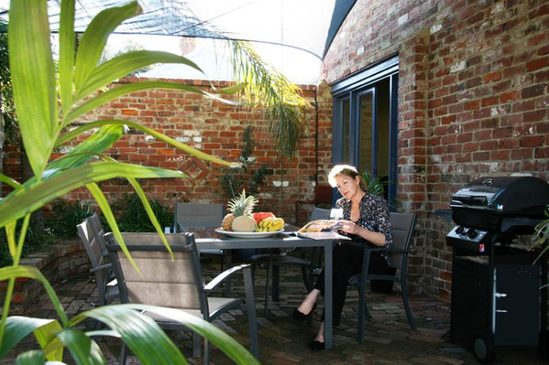 Relax in the comfort of your private courtyard with bbq