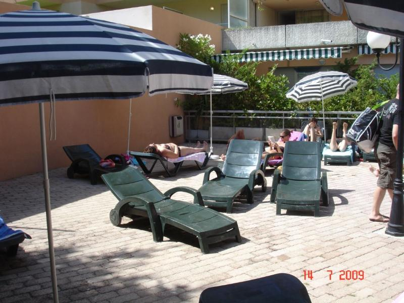 Deckchairs and umbrellas around the pool