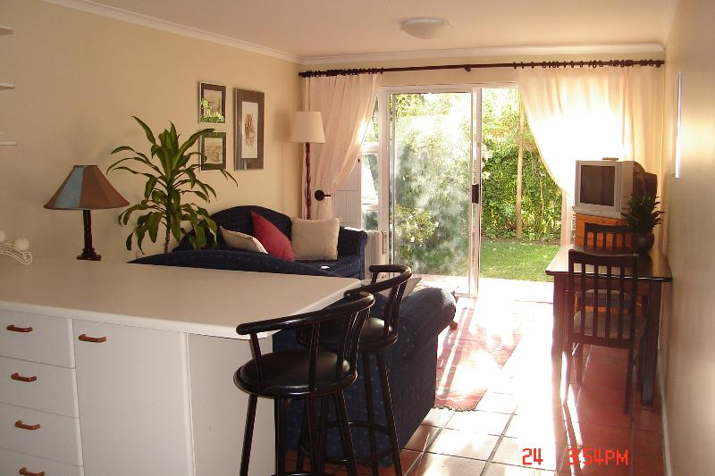 'Cosy Corner Hout Bay.' The Lounge/Kitchen leads out onto a sunny patio and enclosed private garden.