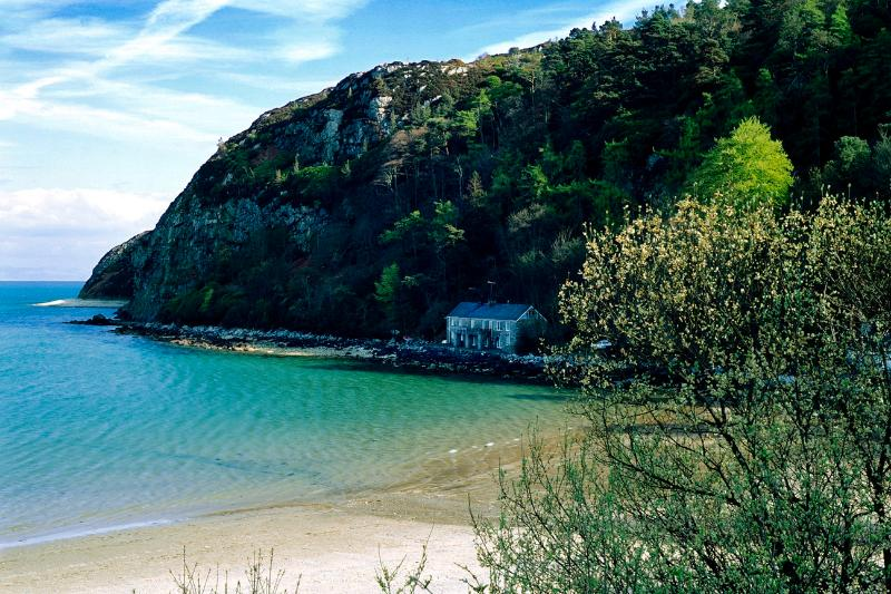The Boathouse in it's staggering position on Llanbedrog Beach