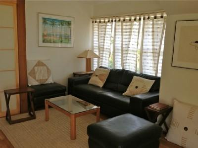 Comfortable living room with ample seating, TV and DVD player.