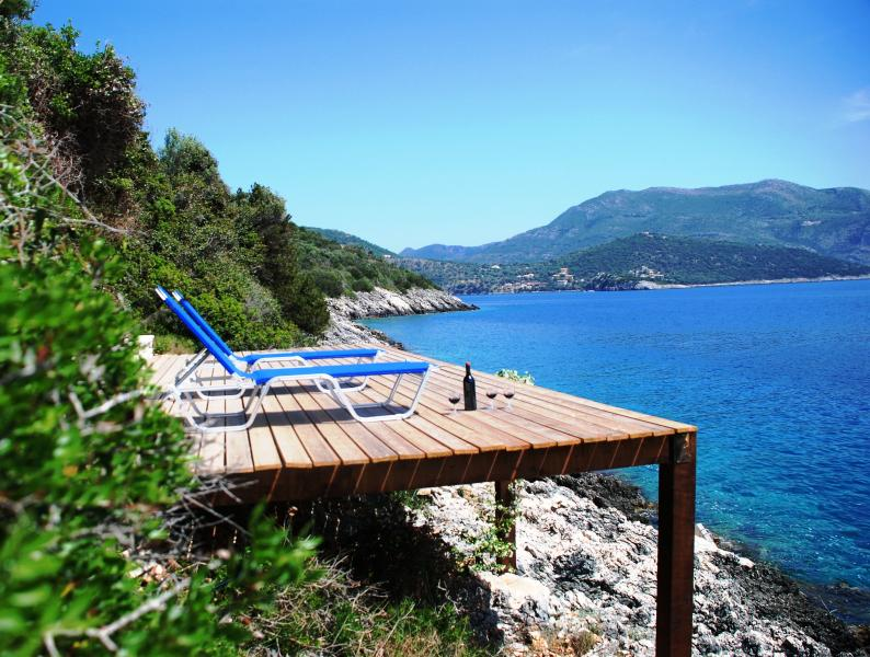 Relax  at this large wooden deck, watch dolfins, have a swim