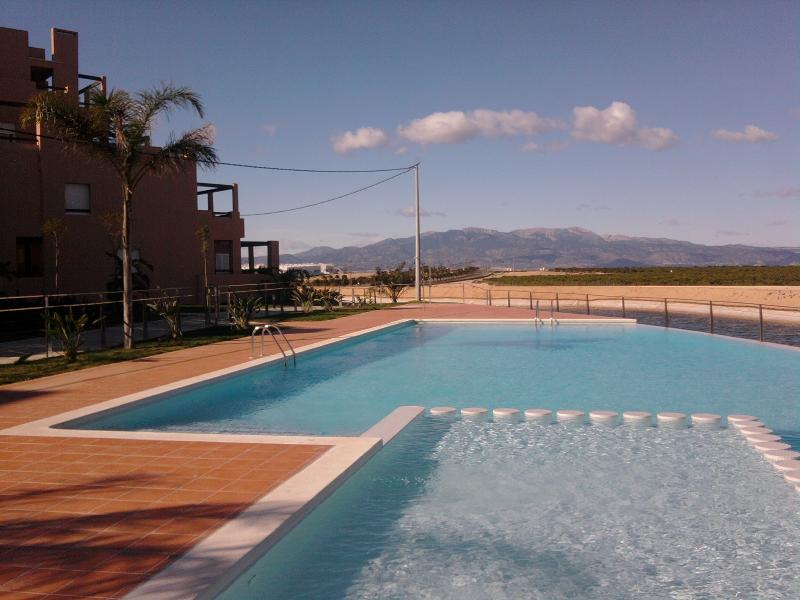 One of the infinity pools on La Isla looking out over the lake & the Sierra Espuna mountains.