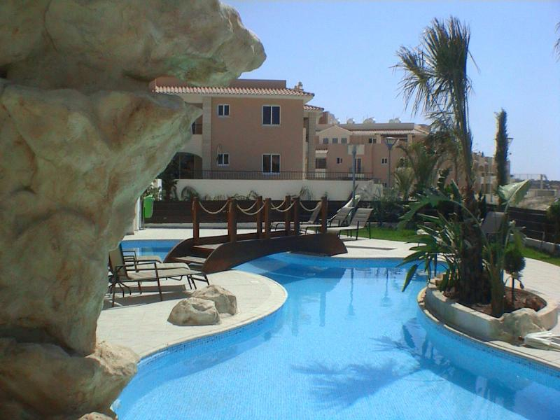 Relax by the pool - just two minutes from your air conditioned, well appointed apartment.