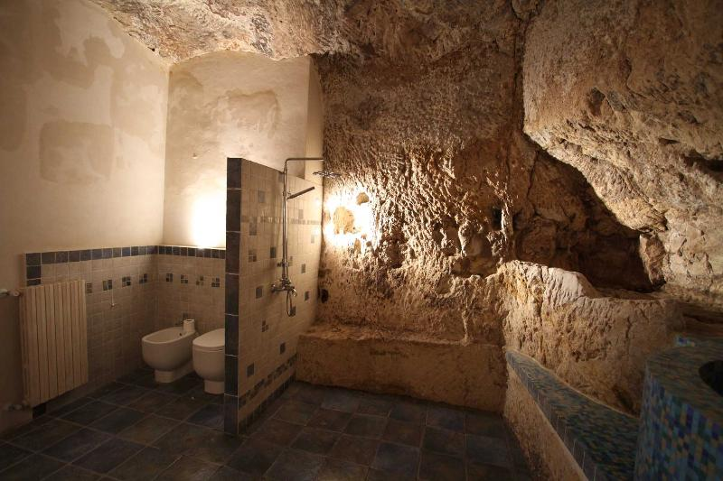 amazing cave bathroom on the ground floor of the main house