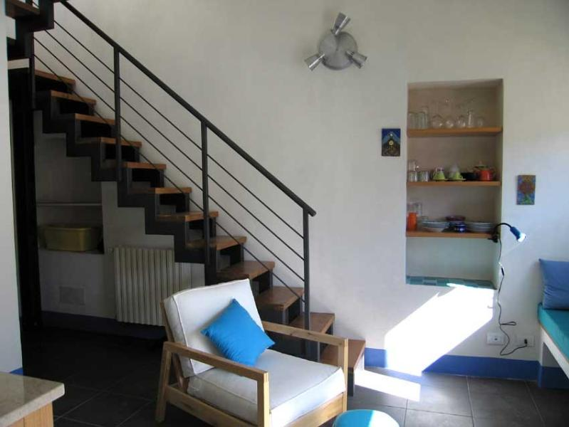 Guests' flat sitting area showing the stairs leading up to the terrace