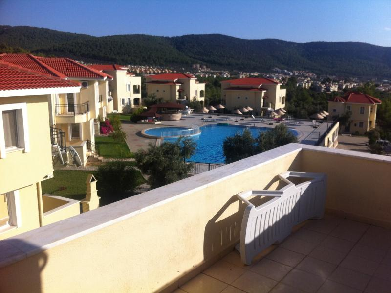 The roof terrace has two sunbeds, views over the pool and a small wall around the edge for privacy.