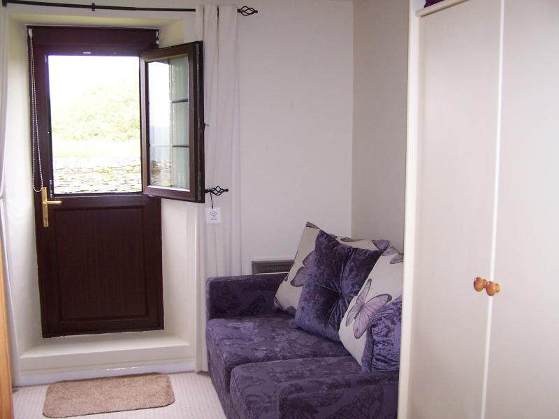 Second Lounge/second bedroom with Double Sofa Bed and door to rear gardens