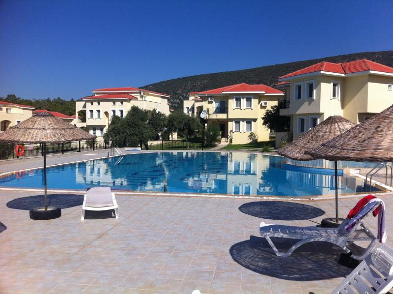 Sun loungers, tables and parasols are provided by the pool and even a selection of kids' inflat