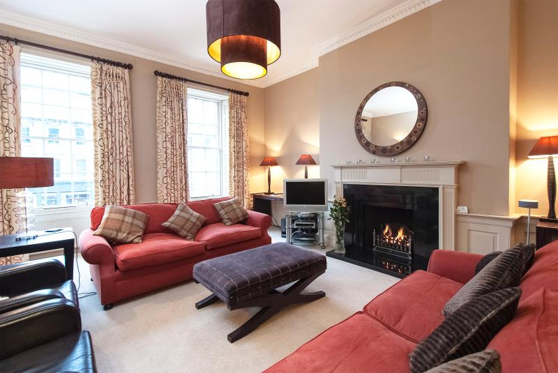 Lounge with remote gas fire in period fireplace surround