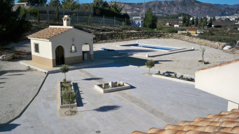 View from the roof terrace of the main house, across the patio to the pool and outbuilding