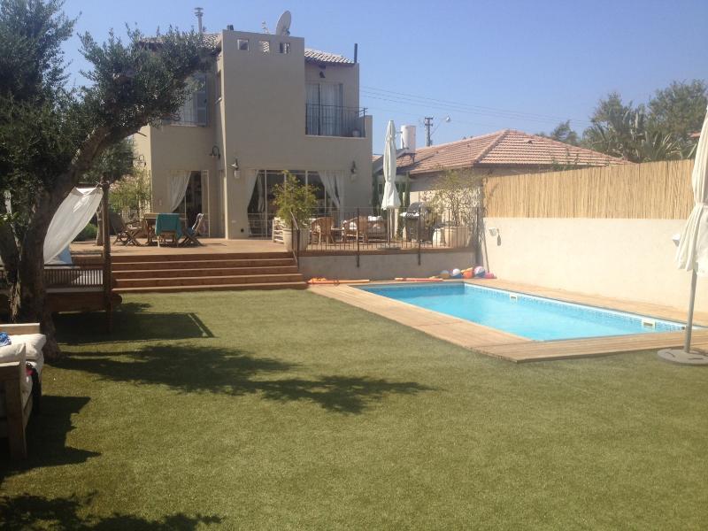 Backyard with pool and leasure area