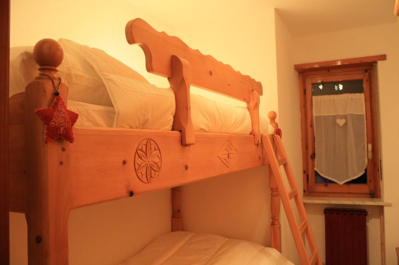 bedroom with regular bunk beds