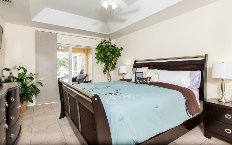 Master bedroom with access to pool