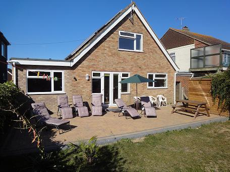 'Woburn' rear of house with large patio,comfortable seating, barbeque, etc