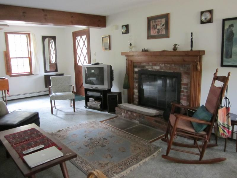 Living room with fireplace and character features