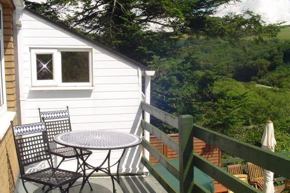 Overboard has two decking areas and a superb outlook down the valley to the beach and sea