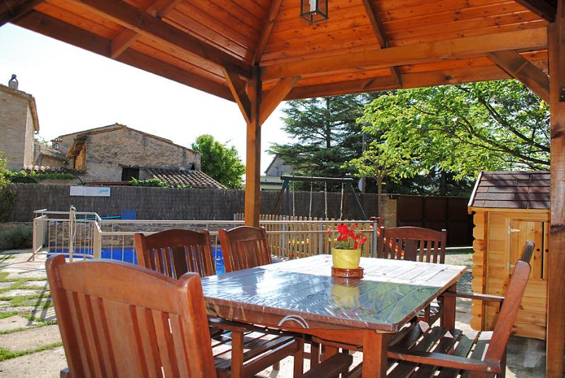 Wooden covered porch which is ideal for eating outside all year round