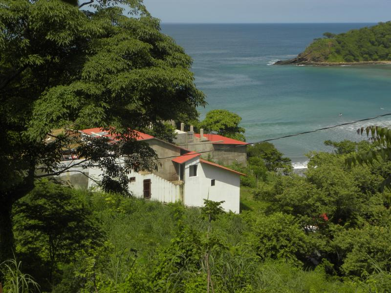 This view is from up the hill looking west. Casa Surfistasnica is closest to the water.