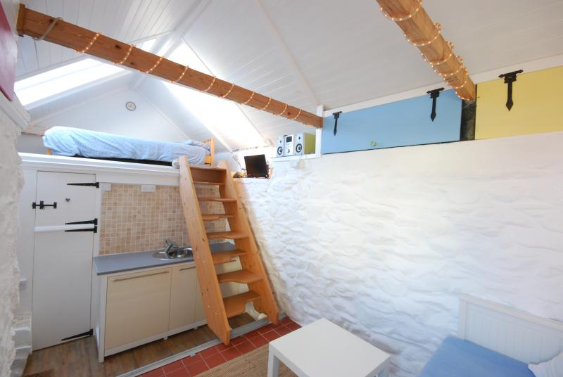 Inside property with moveable stairs