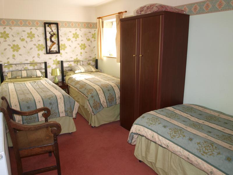 Three bedded room with draws wardrobe etc