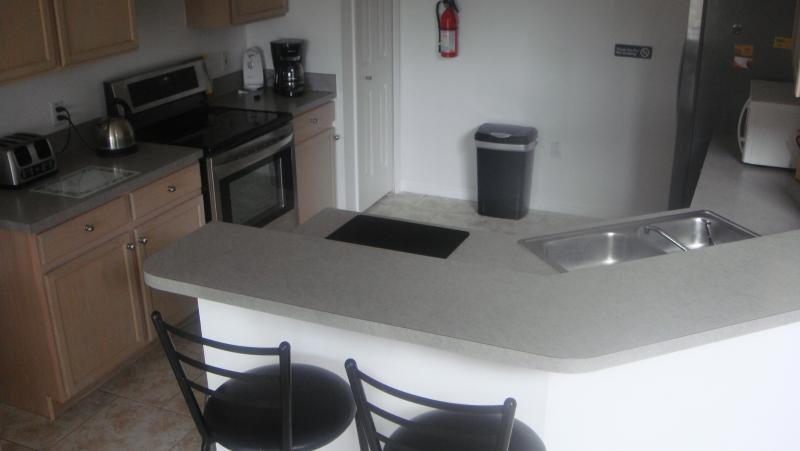 large fully equiped kitchen with breakfast bar