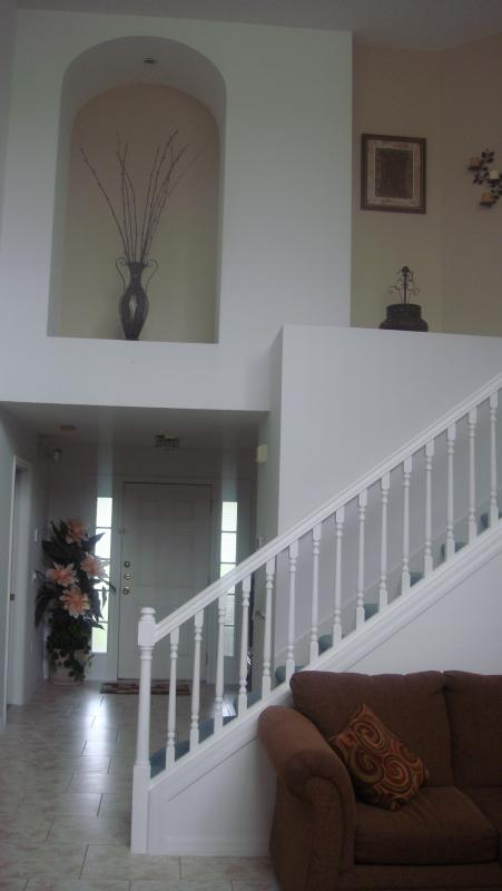 feature staircase from hall overlooking double height lounge