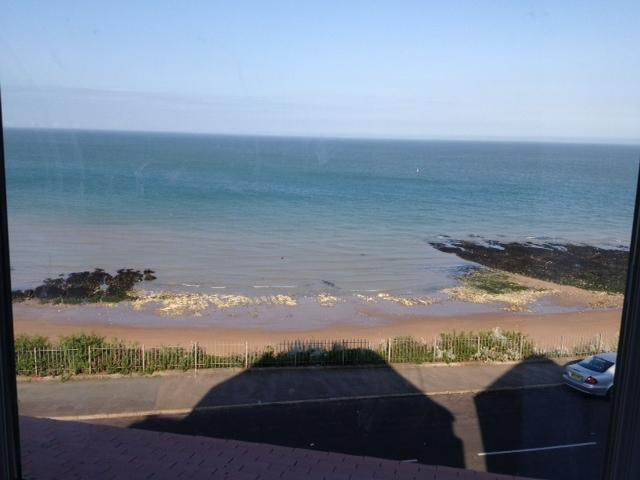 Direct sea views from the apartment onto sandy Stone Bay