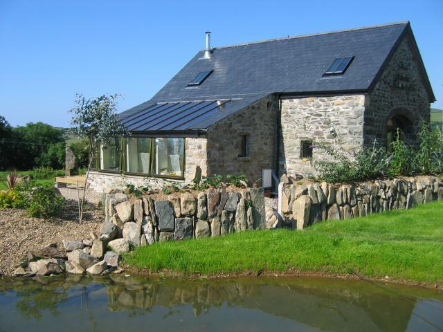 Two large ponds border the cottage with views across the Gwaun Valley to Dinas Mountain